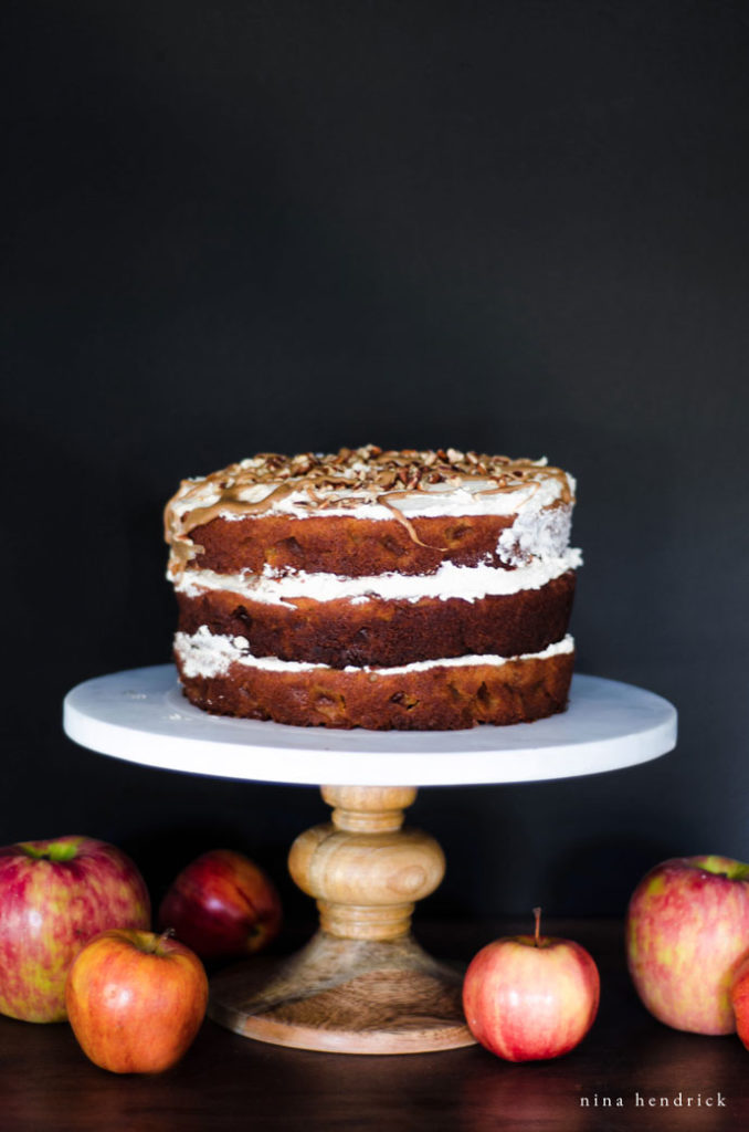 naked cake with salted caramel drizzle on cake stand