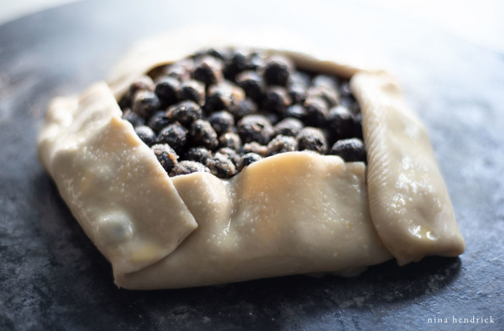 uncooked blueberry galette with egg wash