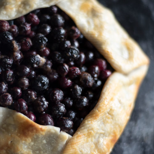 Overhead of rustic blueberry crostata
