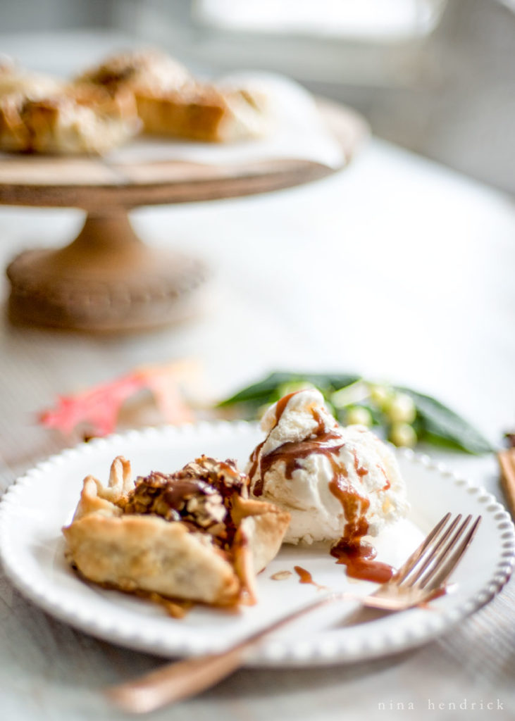 Apple Blossoms Recipe with Salted Caramel Sauce | Get the recipe for these crusty apple blossom tarts with oatmeal and coarse sugar topping and a salted caramel sauce. #applerecipe #appletarts #fallrecipes