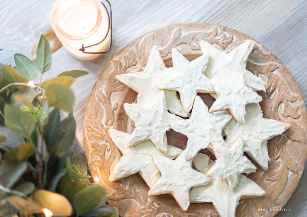 star cookies on a plate with a candle