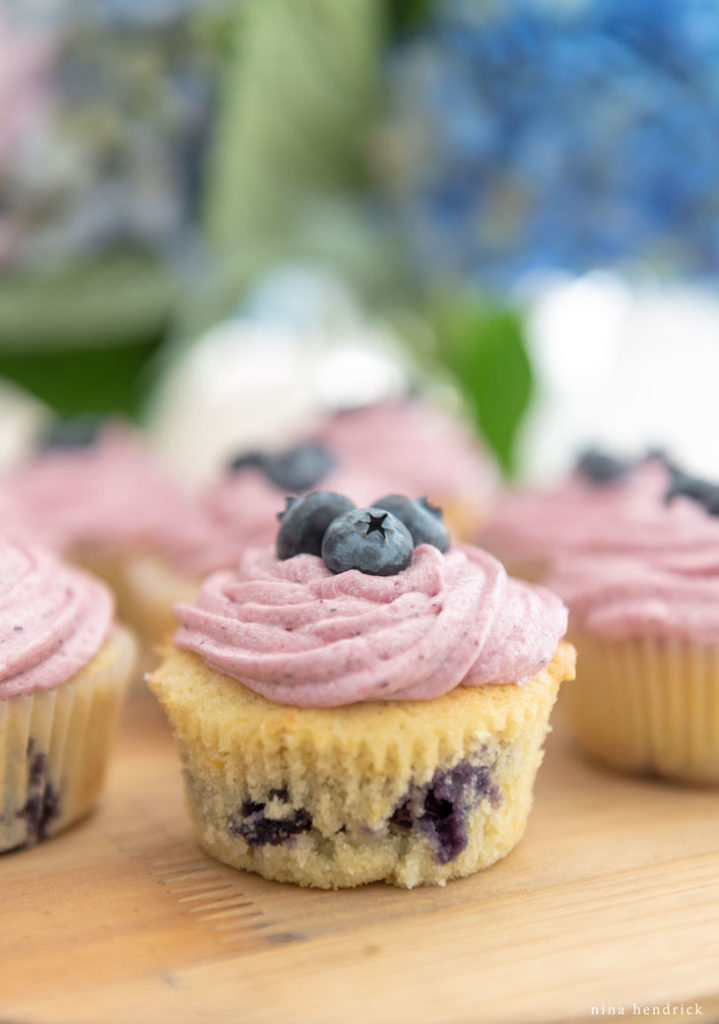 Lemon blueberry cupcakes with blueberry buttercream.