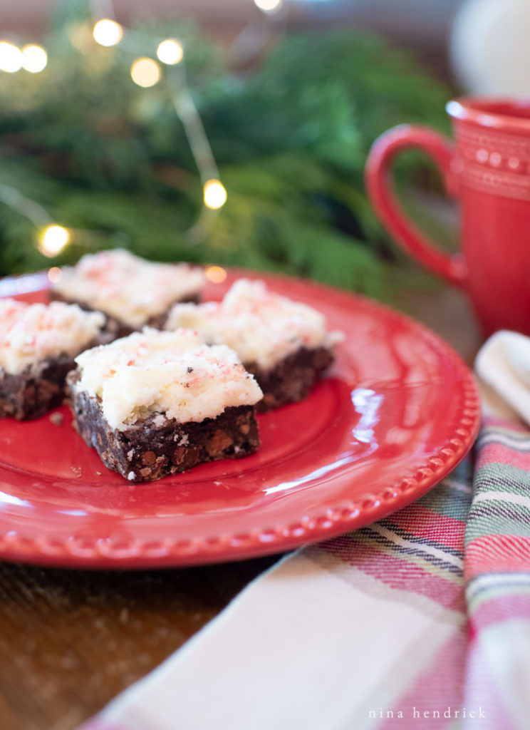 frosted brownies on a plate