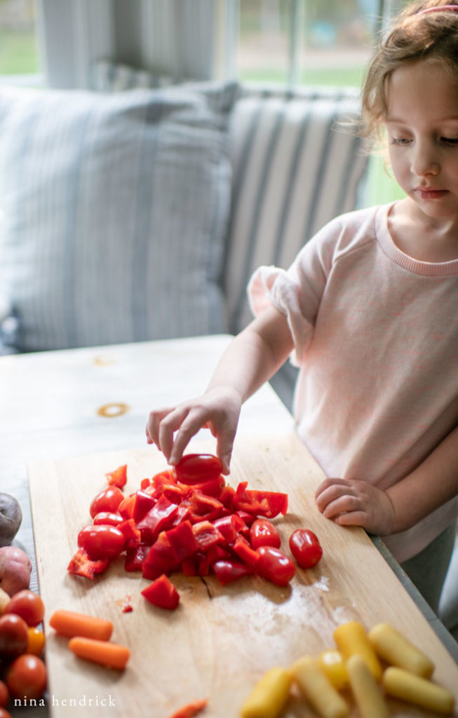 child sorting vegetables by color