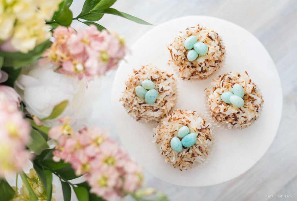 bird's nest cupcakes with toasted coconut and jelly beans