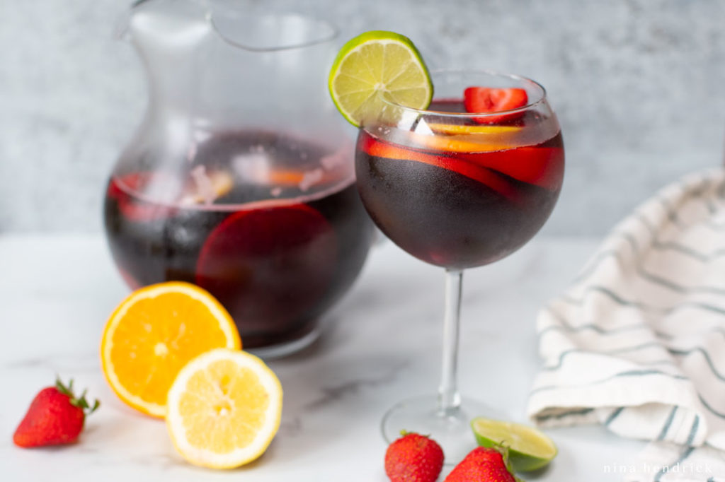 glass of sangria with citrus